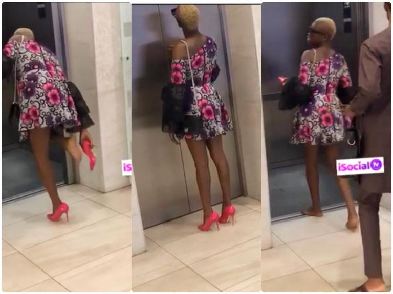 Photo of (Video) KNUST Student Caught Knocking Elevator Door and Removing Her High Heels Before Entering